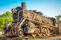 Vintage steam train under sunny sky Stock Photos