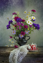 Vintage Still life with a bouquet of wildflowers in a vase Royalty Free Stock Photo