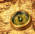 Vintage still life vintage compass lies ancient world map Royalty Free Stock Images