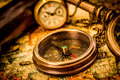 Vintage still life vintage compass lies on an ancient world map Stock Photography