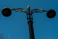 Vintage street lamp on a blue sky Stock Images