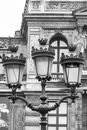 Vintage street lantern in paris france detailed close up front of louvre museum black and white image Stock Photos