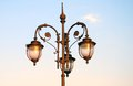 Vintage street light in moscow horizontal photo lights are on blue evening sky with clouds background no people Royalty Free Stock Photography