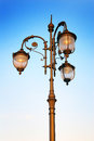 Vintage street light in moscow lights are on blue evening sky background no people Stock Images