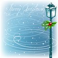 Vintage streetlamp on the evening landscape background christmas in a blizzard Stock Image
