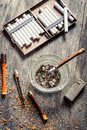 Vintage stuff to smoke a pipe on old wooden table Stock Photography