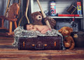 Vintage style baby a studio photo of a newborn sleeping on top of a luggage Stock Photo