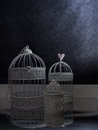 Vintage style birdcages in a dark interior three bird cages decor shabby chic or gothic Royalty Free Stock Image