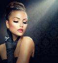 Vintage style girl beauty fashion portrait wearing gloves Royalty Free Stock Photos