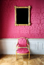 Vintage style interior with chair and blank picture Royalty Free Stock Photo