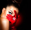 Vintage style mysterious woman wearing red glamour gloves Royalty Free Stock Image