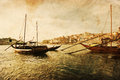 Vintage style picture of ships in porto textured shipson the river douro portugal Royalty Free Stock Image