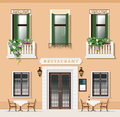 Vintage style restaurant facade. Old-fashioned cafe with tables and chairs.