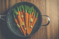 Vintage style rustic carrotts on wood image of carrots with butter and herbs in a pan surface Stock Photos