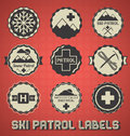 Vintage style ski patrol labels and icons Royalty Free Stock Image