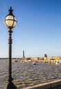 Vintage style street light on margate harbour wall in the sunshine Stock Photo