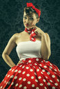Vintage style woman looks interesting in polka dots clothes Royalty Free Stock Photo