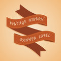 Vintage styled ribbons on orange background Stock Photo