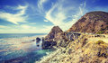 Vintage stylized California coastline along Pacific Coast Highway.