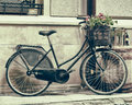 Vintage stylized photo of Old bicycle carrying flowers Royalty Free Stock Photo