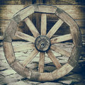 Vintage stylized photo of wooden cart wheel Royalty Free Stock Image
