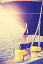 Vintage stylized yellow bollard holding ship moored. Royalty Free Stock Photo