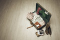 Vintage suitcase open on a wood floor in an empty room Royalty Free Stock Photos