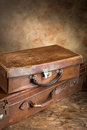 Vintage suitcases two closed very old leather with copyspace Royalty Free Stock Image