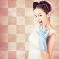 Vintage surprised pinup woman doing housework photo of a with hairstyle and makeup wearing washing up mitt domestic Stock Images