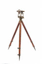 Vintage Surveyor's Level (Transit, Theodolite) on a Wooden Tripod isolated on White. Royalty Free Stock Photo