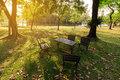 Vintage table with chairs near urban lake in summer Royalty Free Stock Photo