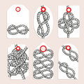 Vintage tags with eternity eight knot Royalty Free Stock Photo