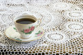 Vintage Teacup on Crochet Tablecloth Stock Photos