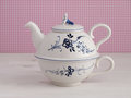 Vintage teapot with floral motif elegant pink vichy background Stock Images