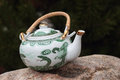 Vintage teapot on a stone Royalty Free Stock Photo
