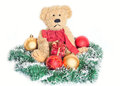 Vintage teddy bear over christmas decoration Royalty Free Stock Images