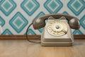 Vintage telephone on diamond wallpaper Royalty Free Stock Photo
