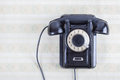 Vintage telephone on old retro wall paper Royalty Free Stock Photo