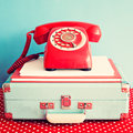 Vintage telephone over books and suitcase Royalty Free Stock Photo
