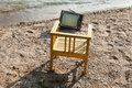 Vintage television on beach decor the lake shore chair and Stock Photos