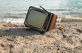 Vintage television on the lake shore Stock Photos