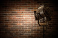 Vintage theater/movie spot light focused on a brick wall background Royalty Free Stock Photo
