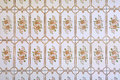 Vintage tiles with floral pattern kitchen wall in a house built in s background Royalty Free Stock Photography
