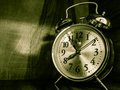 The vintage timepiece beautiful image with in a green darken background Royalty Free Stock Image