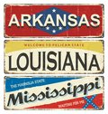 Vintage tin sign collection with America state. Arkansas. Louisiana. Mississippi. Retro souvenirs or postcard templates on rust ba Royalty Free Stock Photo