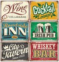 Vintage tin signs collection with various drinks and beverages themes Royalty Free Stock Photo