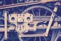 Vintage toned old rusty steam locomotive wheel Royalty Free Stock Photo
