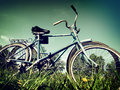 Vintage toned photo two vintage bicycles summer meadow Stock Images