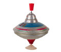 Vintage toy top spinning isolated on white Royalty Free Stock Images