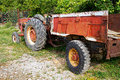 A Vintage Tractor and Red Trailer Royalty Free Stock Photo